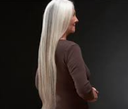 Mature lady with long, silver hair.