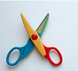 Image of child's multi-coloured craft scissors.