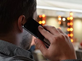 A male on his cellphone.